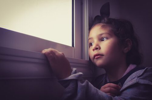 girl looking at window